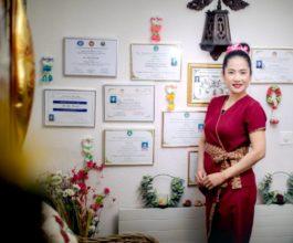 Atipa with her diplomas